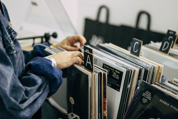 Person looking through music albums. Stay KooooK. Stay You.